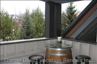Wine Barrel Table and Bar Stools Adjacent to the Hot Tub on the Top Deck ... Ahhhh!