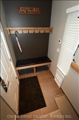 Heated Entry Way for Warm Arrivals; Coat Rack; Helmet Shelf; Padded Leather Bench