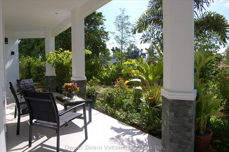 Ground Floor Terrace , the Perfect Place to Relax , Shaded by Palm Trees.