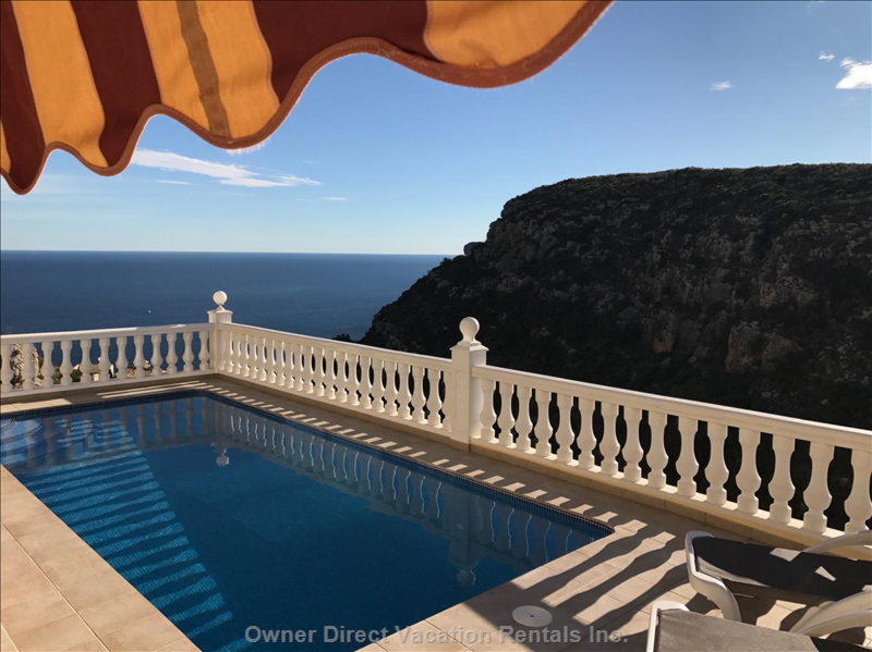 Just Imagine these Views from your Sun Lounger...Across the Heated Pool to the Mediterranean Sea, with the Lush Green Hillside Opposite