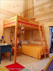 Bunk Room with Toys and Books. Vaulted Ceilings, Bird Motif Frescoes.