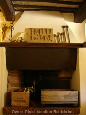 The Ancient Fireplace in the Dining Room