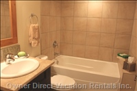 The Main Bath has a Soaker Tub and Shower, as well as a High-E Front Load Washer & Dryer.