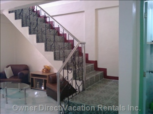 Staircase - Tiled and Wrought Iron/Stainless Steel