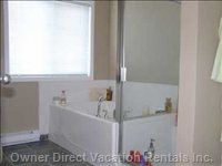 Main Bathroom Showing Soaker Tub and Glass Enclosed Shower