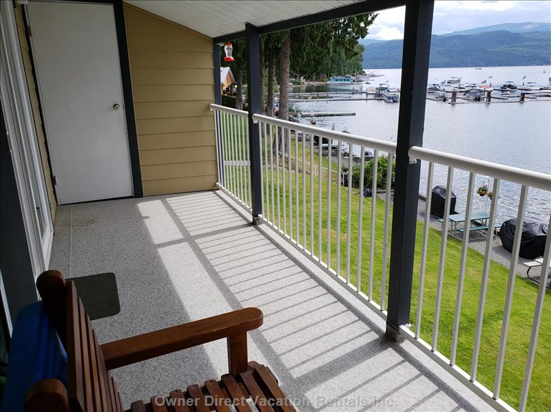Comfortable Patio Furniture Allows you to Lounge and Take in the Serene Lakefront Views.