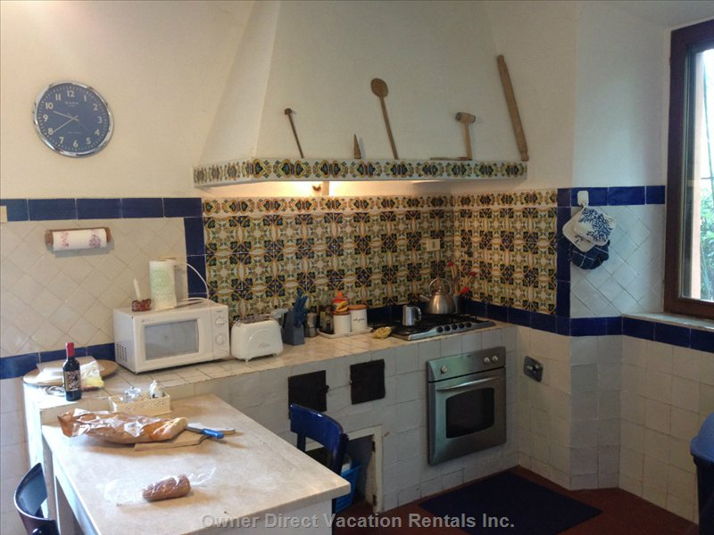 The Fully Equipped and Modern Kitchen with Gas Stove and Electric Oven