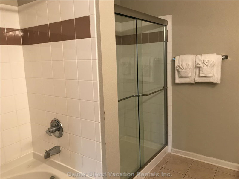 Shower Glass Door Was Recently Installed in En-Suite Master Bathroom