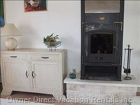 Wooden Stove - this Can be Used for the Colder Months of the Year. Heats Very Well besides the Electricity Heating Systems.