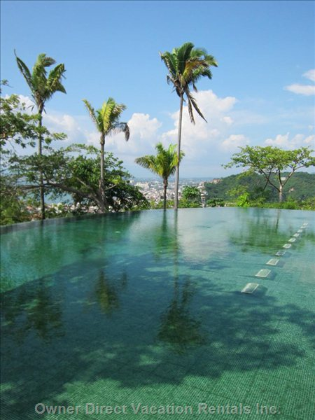Second Infinity Pool Includes a Sumptuous Green Garden and Sun Tanning Area