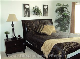 Master Bedroom - Deluxe Master Bedroom with Top Quality Queen Sized Mattress, plus Small Flatscreen TV for your Enjoyment