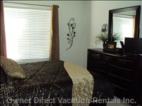 Master Bedroom - Large Dresser with Mirror, Night Table Next to Bed, Alarm Clock, Small Screen TV