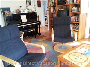 The Living Room--Enjoy Playing the Piano Or Watching one of our Dozens of Movies...