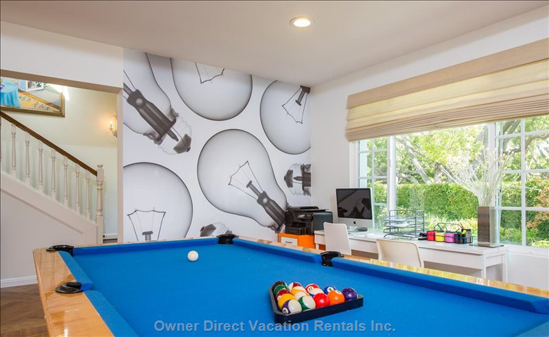 Game Room with Pool Table and Mac Computer