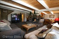Large Living Area with Big Screen TV and Incredible Mountain Slopes Views!