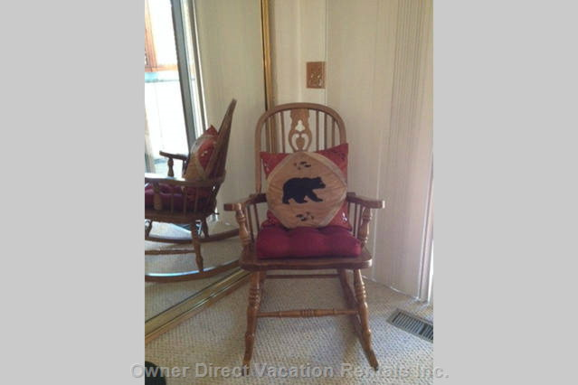 Comfy Rocking Chair with Bear Pillow in Master Bedroom.