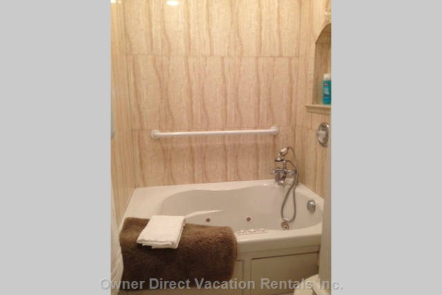 Master Bathroom has Jacuzzi Tub/ Shower Combination.