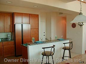 European Cabinetry & Granite Counters Complete the Kitchen.