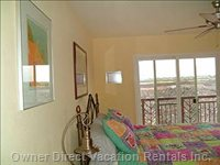 Upstairs Mbr has a Luxurious King-size Bed and Views of Waim