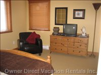Master Bedroom - Private Ensuite, Walk in Closet, TV, Leather Lounge Chair. Nintendo 64 with Two Games and Controlers