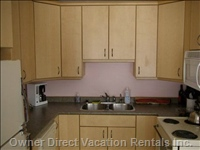 Fully Equipped Kitchen with Custom Maple Cupboards