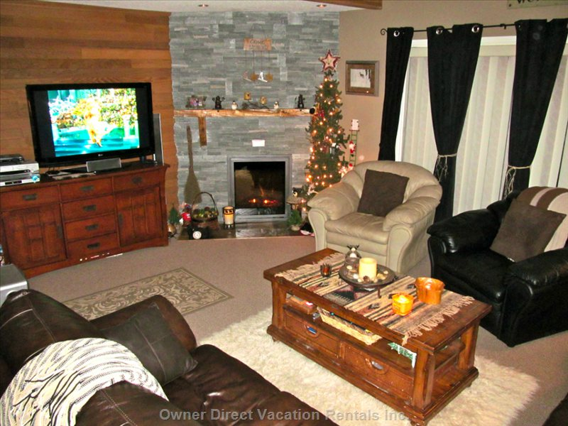 Very Cozy Living Area with Leather Couches and Full Sized Leather Chairs. Electric Fireplace for Warm Ambience.