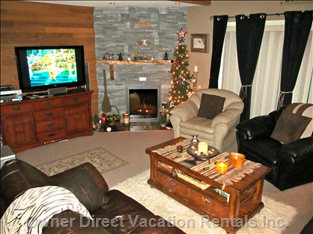 Very Cozy Living Area with Leather Couches and Full Sized Leather Chairs. Outside Deck has Private Bbq for your Use.