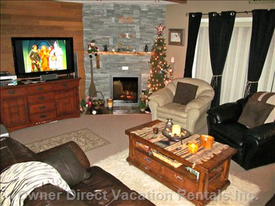 Warm Cozy Living Room with Floor to Ceiling Fireplace and 47 Inch Led Tv Surround Sound with 79 Hd Channels and Pvr and Blue Ray Dvd