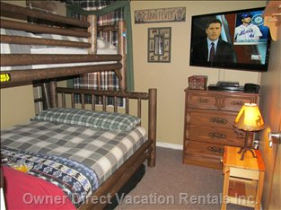 Middle Bedroom with Deluxe Double Lower Bunk and Single Upper Bunk. 40 Inch Led TV with 79 HD Channels and Blue Ray/DVD.