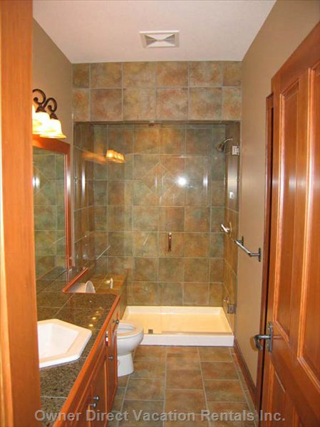 Main Bathroom with Steam Shower is Accessed from the 2nd Bedroom and Hallway