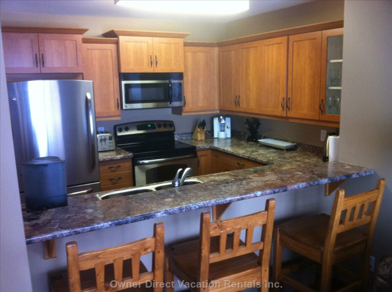 Well Equipped Kitchen with New Appliances and Cabinets