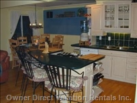 Gourmet Kitchen with Gas Jennaire and Snack Bar Close to Dining Room