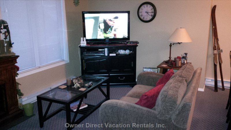 Entertainment Central with hd Tv, hd Cable with Pfv, hd Dvd and Wii.  Games in Sideboard for all Ages.  Flooring has Been Updated!
