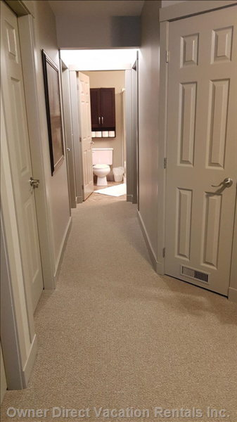 Hallway Leading to Bathroom #2.  Door on Left Opens into a Large Ski Closet.  There is Also a Ski Locker Located at Garage Level.