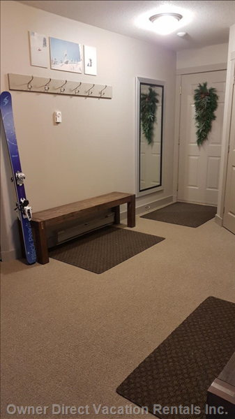 Large Entrance with 2 Benches for Putting on Taking off your Ski Boots.