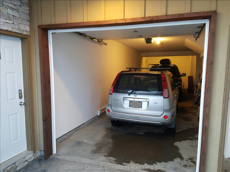 Large Tandem Garage Can Easily Fit Two Suv's with Roof Boxes.