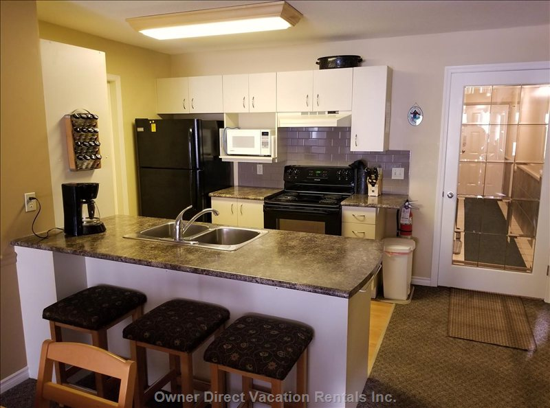 Fully Equipped Kitchen with Eating Bar and Stools