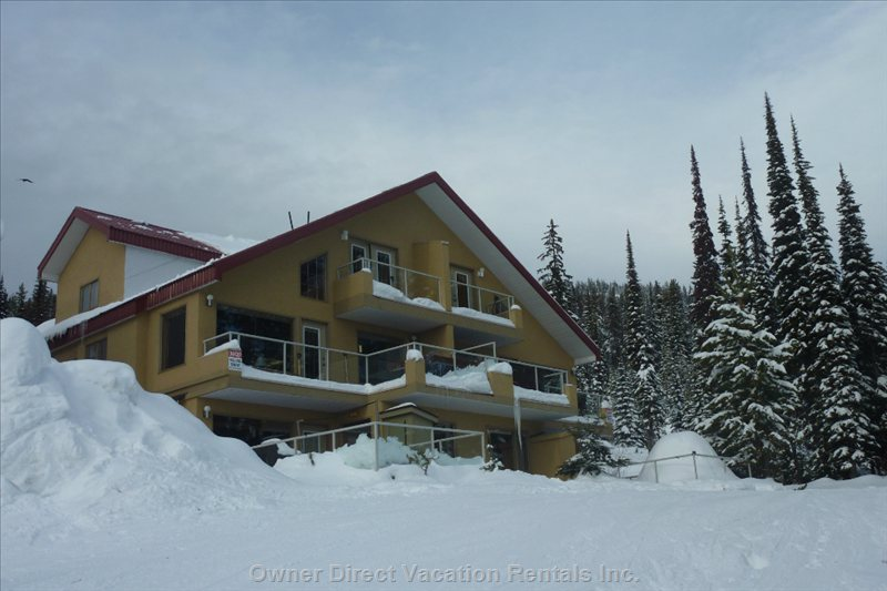 Back of Chalet from Ski Run (Lower Serwa), Unit is Upper Two Levels Left Side
