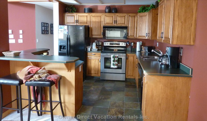 Spacious, well-Appointed Kitchen. 4-Person Eating Bar.