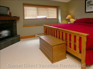 Master Suite with Fireplace - King Size Bed. Ensuite Bathroom with Jetted Tub.