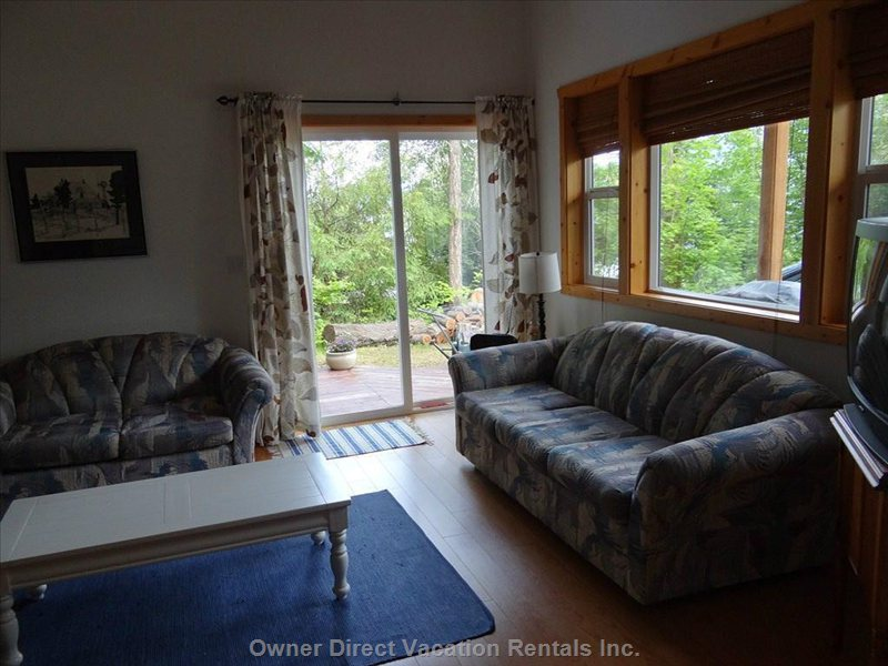 This Room has Lots of Space for Visiting, Watching T.v., Sitting by the Wood Stove and Hanging out!  Sliding Door Leads out to Deck.