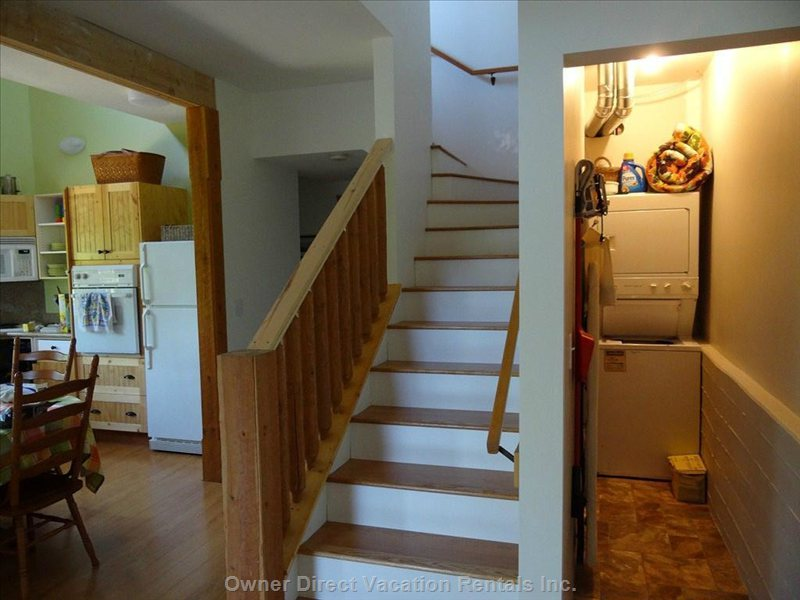 These Stairs Lead to the Loft with Laundry Tucked under the Stairs.
