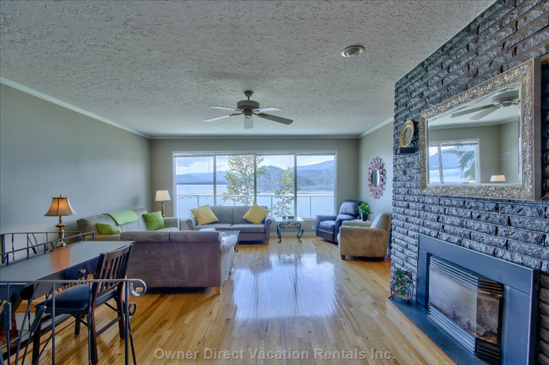 Spacious Living Room with 9' Ceilings, Extra Large Windows & Views of the Lake