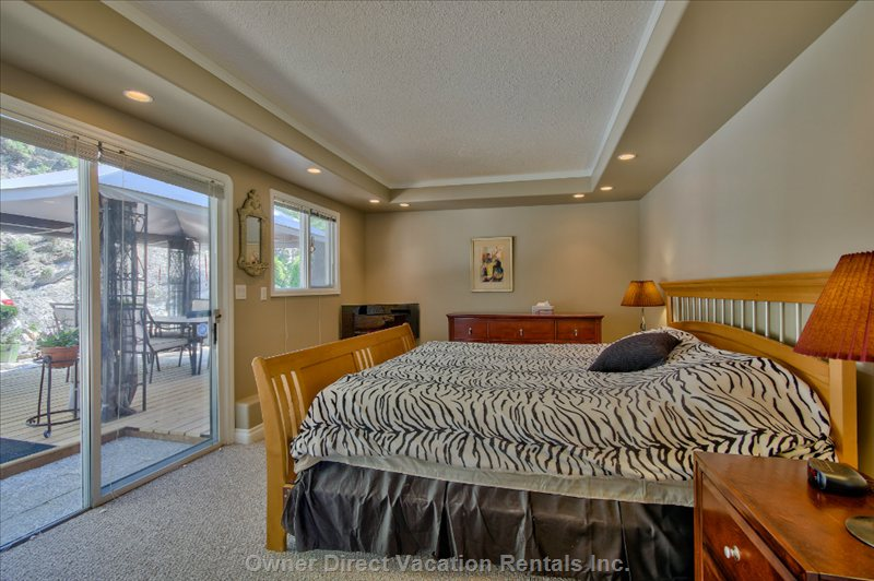 Master Bedroom with Electric Fireplace, 3 Piece Ensuite & Access to Garden Patio