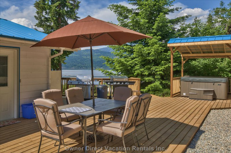 Backyard Patio Area with 2 Natural Gas Bbq's and Wonderful Views of the Lake!!