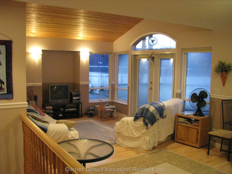 Living Room has Fanatastic View of Lake.