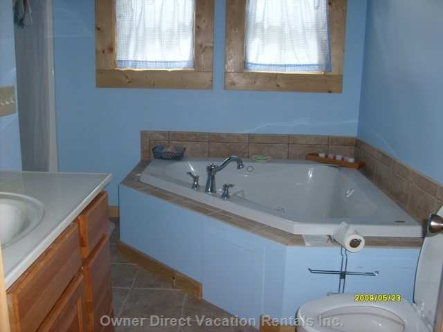Master Bedroom Bathroom - End a Perfert Day in this Jetted-jacuzzi and Relive the Moments.
