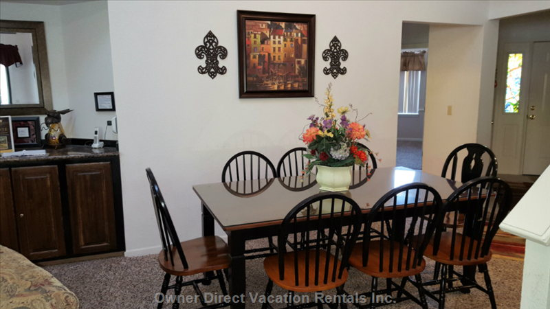 Seating for 8 at Dining Room Table.  Another 2 Places to Sit at the Bar Nearby. Table for 4 in Kitchen Breakfast Nook
