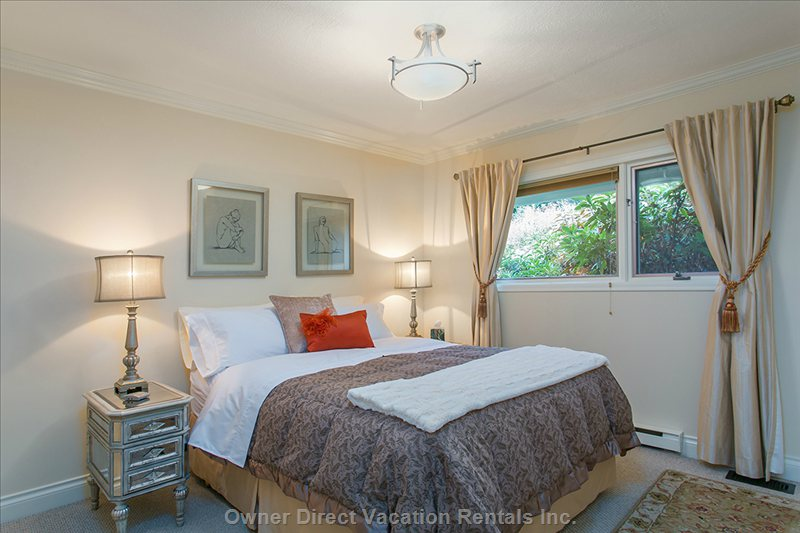Bedroom with Luxurious New Queen Bed, Fine Linens down Comforter and Cosy Robes. A View of the Garden