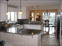 Kitchen - Bright, Spacious, Highly Functional Kitchen with Granite Tops